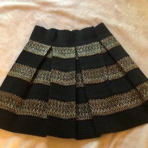 A'gaci black, gold, silver pleated skirt